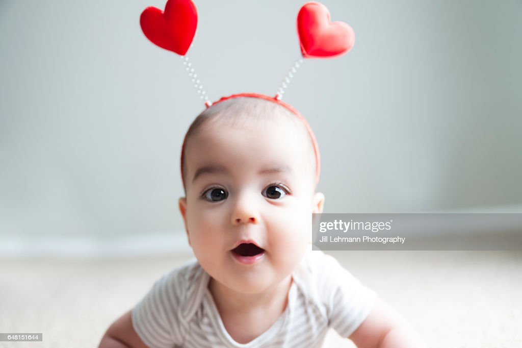 Valentine's Day Baby Poses for Camera : Stock Photo