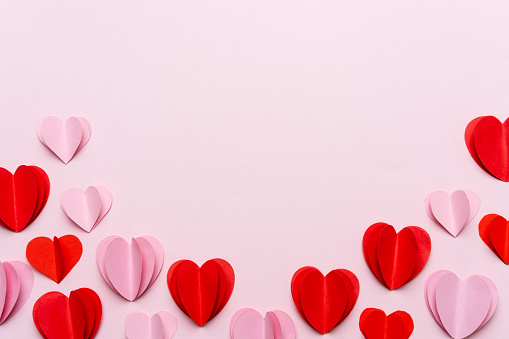 Valentine's Day background with red hearts on pink background 1186052670