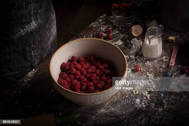 Valentines Day baking. A high angle view of a bowl of fresh raspberries.