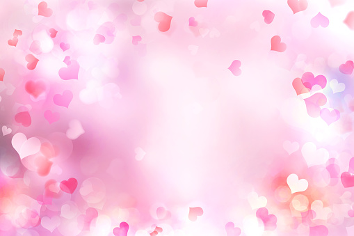 Valentine's day blurred hearts background. 900009520