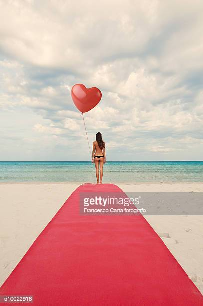 valentine's day - brief.woman whit heart-shaped balloon - valentine' day stock pictures, royalty-free photos & images