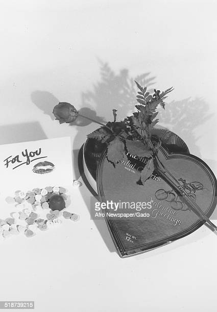 Valentines day chocolate gift box and rose 1975