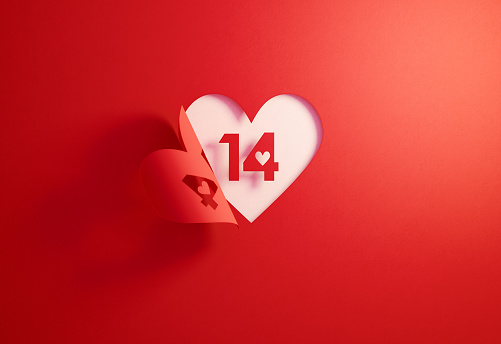 Valentine's Day Concept- Number 14 Inside Of A Red Folding Heart Shape On White Background 1083484666