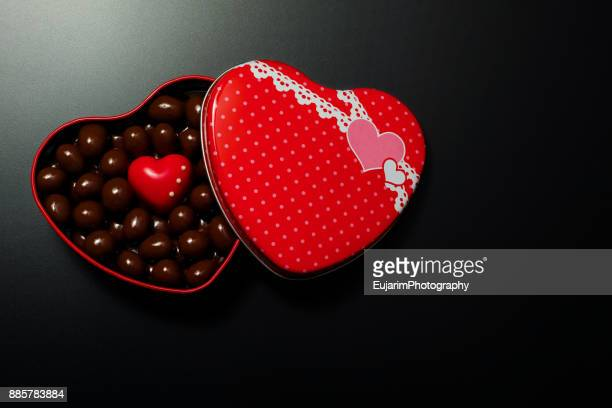 Valentine's day concept with red heart shaped box full of chocolate