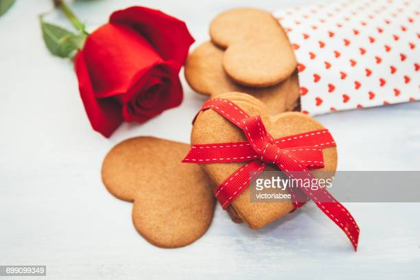 Valentine's Day cookies and a red rose