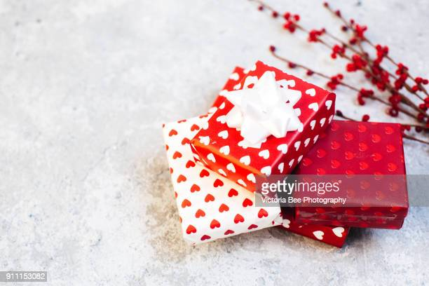 valentines day gift boxes - heart month stock photos and pictures