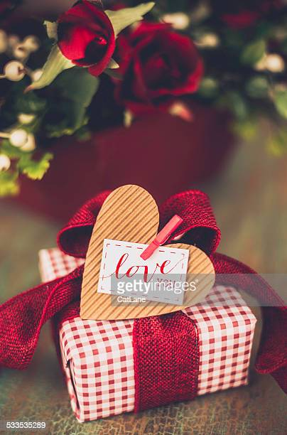 valentine's day gift with love you message - heart month stock photos and pictures