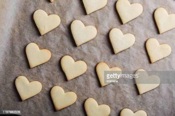 valentines day heart shape cookies - baking sheet stock pictures, royalty-free photos & images