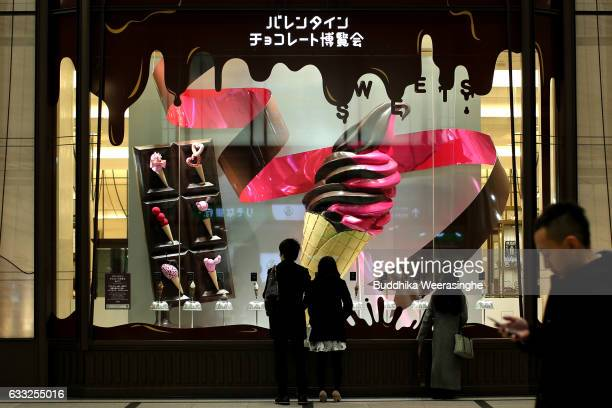 Valentine's Day ice cream advertisement seen in the window of the Hankyu Department Store on February 1 2017 in Osaka Japan The Hankyu department...