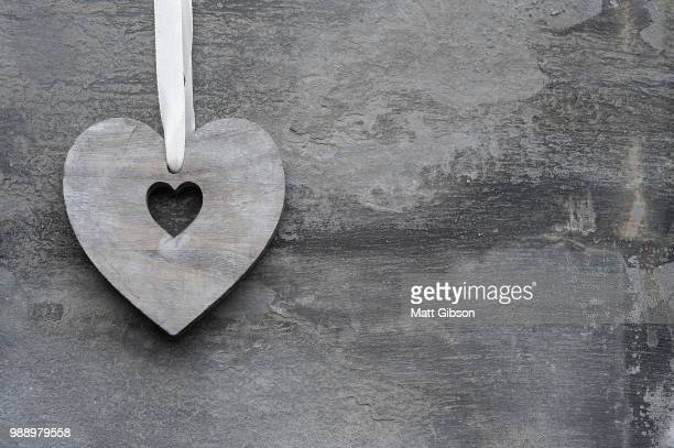 valentine's day love heart on rustic style background - animal internal organ stock photos and pictures