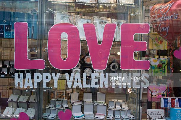 A valentines Day merchandise retail window in the City of London The word Love has been pasted on to the window in large lettering above Happy...