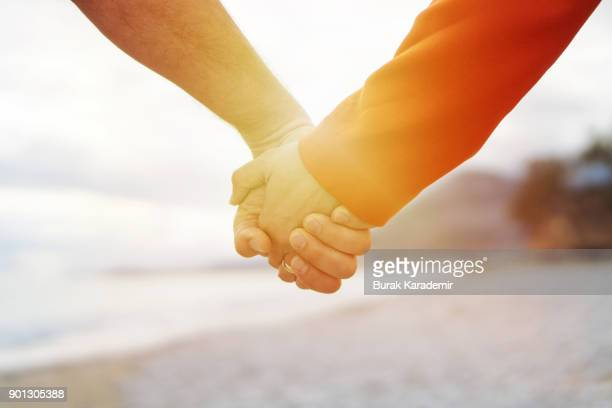 valentine's day - holding hands stock pictures, royalty-free photos & images