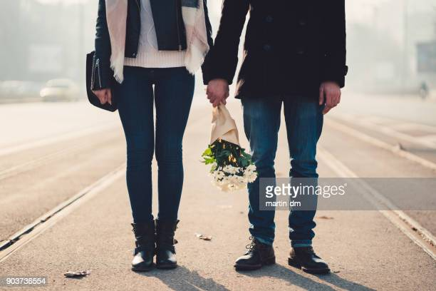 valentine's day - man touching womans leg stock photos and pictures