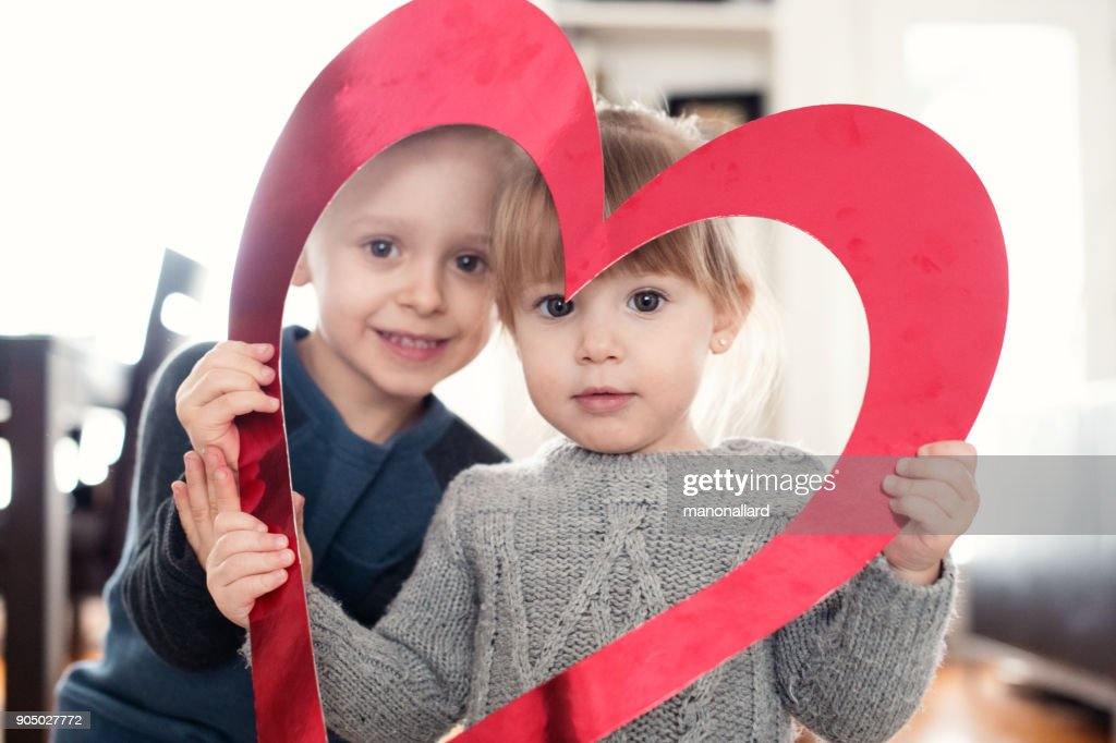 Valentines Day With A Lovely Girl And Boy Holding Red Heart Shape ...