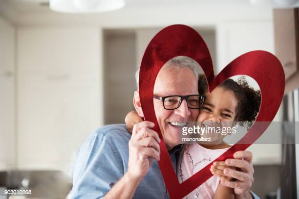 valentine's day with multi-ethnic family - valentine's day stock photos and pictures