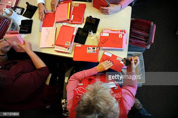 Valentines02e Susie Sermershim 59, at her volunteer work station Monday morning, Feb. 2, as seniors and postal workers start stamping valentines,...