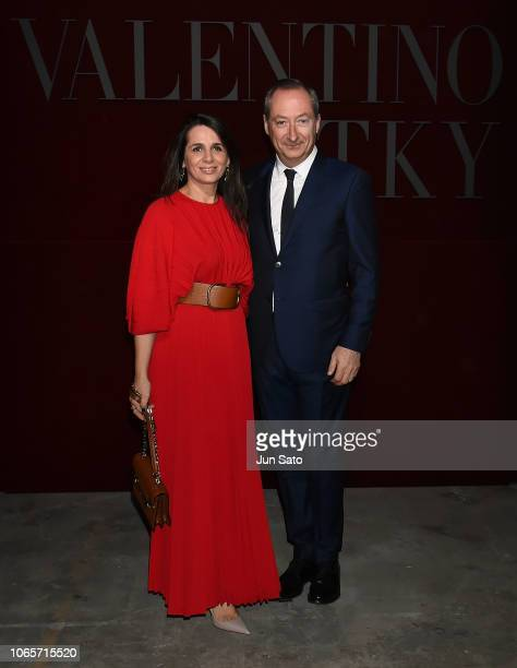 Valentino CEO Stefano Sassi and Enrica Sassi attend the photocall for Valentino TKY 2019 Pre-Fall Collection at Terada Warehouse on November 27, 2018...