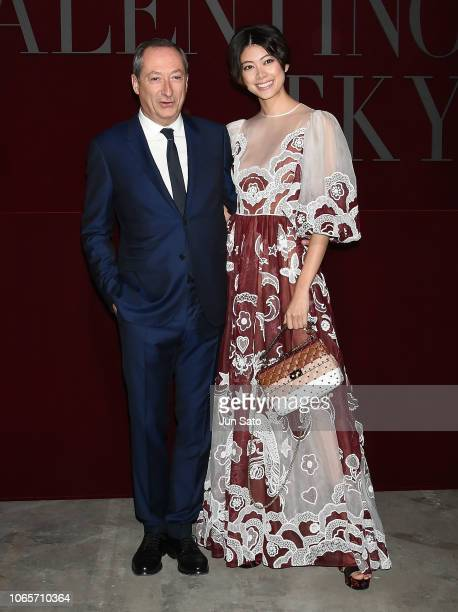 Valentino CEO Stefano Sassi and model Hikari Mori attend the photocall for Valentino TKY 2019 Pre-Fall Collection at Terada Warehouse on November 27,...