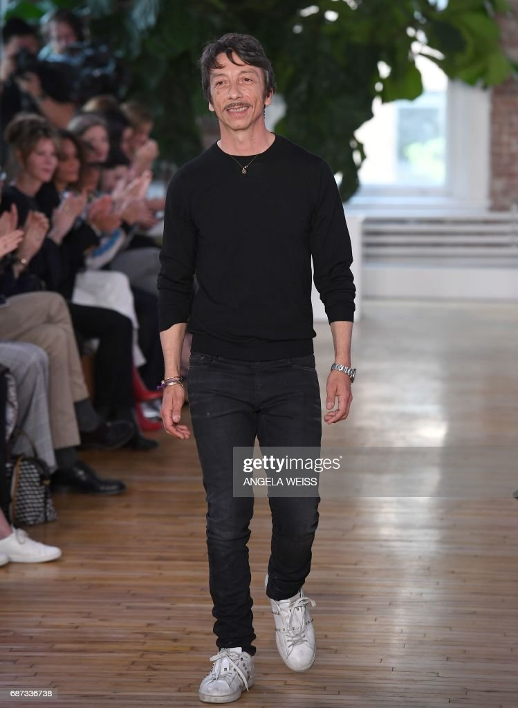 Valentino creative director Pierpaolo Piccioli salutes the members of the audience the Valentino Resort 2018 runway show on May 23, 2017 in New York City. /