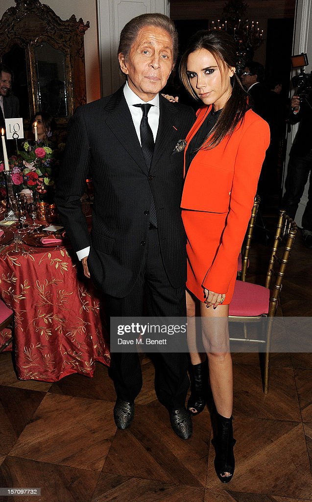 Valentino Garavani (L) and Victoria Beckham attend a dinner celebrating the launch of 'Valentino: Master Of Couture', the new exhibition showing at Somerset House from November 29, 2012 to March 3, 2013, at the Italian Embassy on November 28, 2012 in London, England.