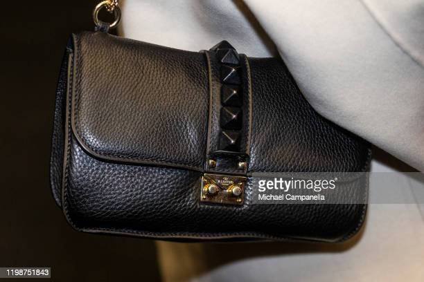 Valentino handbag worn by Crown Princess Victoria of Sweden attends the Folk and Culture 2020 festival at STIGA Sports Arena on February 5 2020 in...