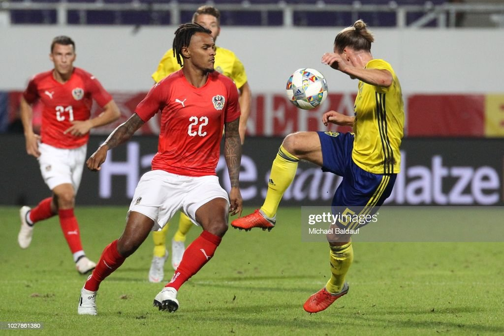 Valentino Lazaro of Austria and Niklas Hult of Sweden during the internationl friendly match between Austria and Sweden at Generali Arena on September 6, 2018 in Vienna, Austria.