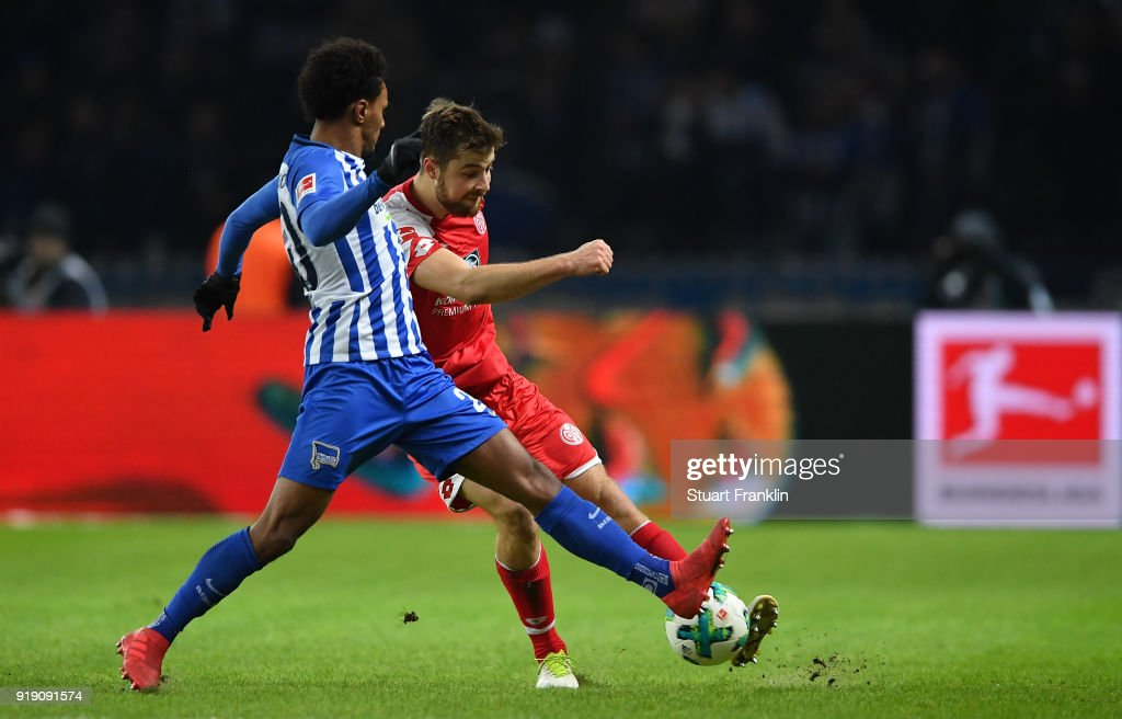 Valentino Lazaro of Berlin is challenged by Alexander Hack of Mainz during the Bundesliga match between Hertha BSC and 1. FSV Mainz 05 at Olympiastadion on February 16, 2018 in Berlin, Germany.