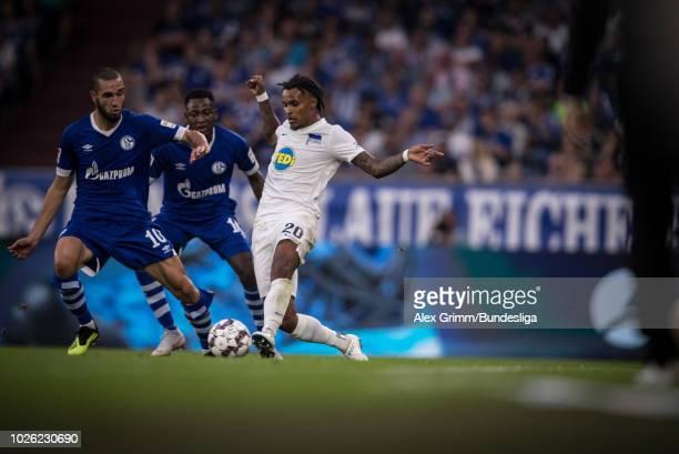 Valentino Lazaro of Berlin is challenged by Nabil Bentaleb of Schalke during the Bundesliga match between FC Schalke 04 and Hertha BSC at...