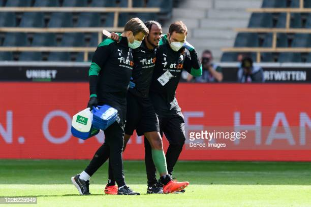 Valentino Lazaro of Borussia Moenchengladbach is injured during the preseason friendly match between Borussia Monechengladbach and SpVGG Fuerth at...