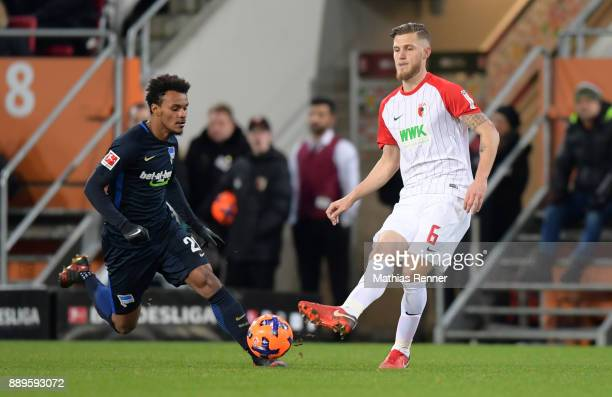Valentino Lazaro of Hertha BSC and Jeffrey Gouweleeuw of FC Augsburg during the game between dem FC Augsburg and Hertha BSC on december 10 2017 in...