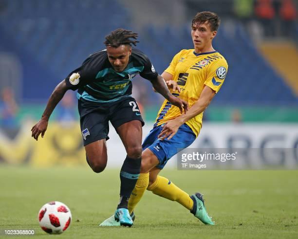 Valentino Lazaro of Hertha BSC and Malte Amundsen of Eintracht Braunschweig battle for the ball during the DFB Cup first round match between...
