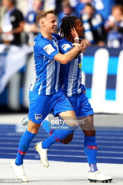 The team of Hertha celebrate with their fans after winning the Bundesliga match between Hertha BSC and Borussia Moenchengladbach at Olympiastadion on...