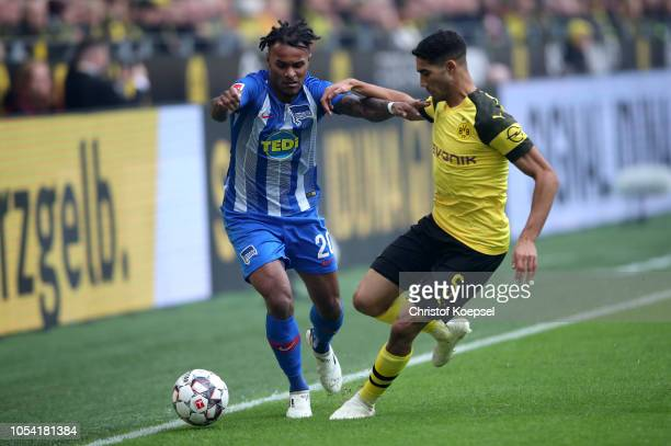 Valentino Lazaro of Hertha BSC is challenged by Achraf Hakimi of Borussia Dortmund during the Bundesliga match between Borussia Dortmund and Hertha...