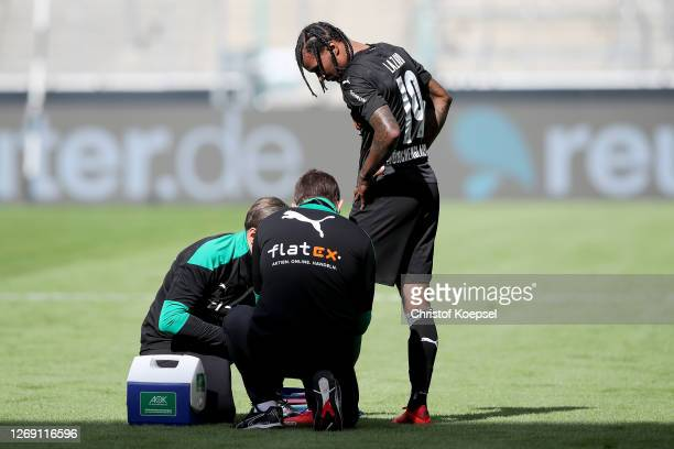 Valentino Lazaro of Moenchengladbach alks off the pitch after an injury during the preseason friendly match between Borussia Monechengladbach and...