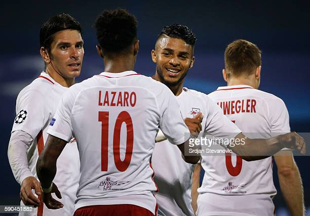 Valentino Lazaro of Salzburg celebrate scoring a goal with the team mates Wanderson and Jonathan Soriano during the UEFA Champions League Playoffs...