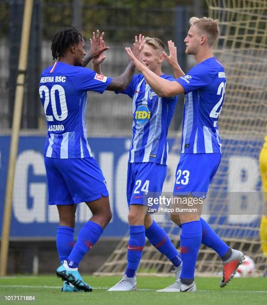 Valentino Lazaro, Palko Dardai and Mitchell Weiser of Hertha BSC celebrate after scoring the 4:0 during the game between Hertha BSC and Hallescher FC...