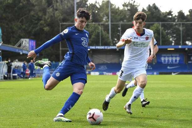 Valentino Livramento of Chelsea cuts the ball across Sam Birch of Flyde during the Chelsea U18 v AFC Fylde U18 FA Youth Cup at Kingsmeadow on April...