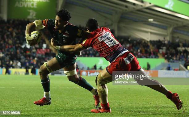 Valentino Mapapalangi of Leicester Tigers holds off Alafoti Faosiliva of Worcester Warriors during the Aviva Premiership match between Leicester...
