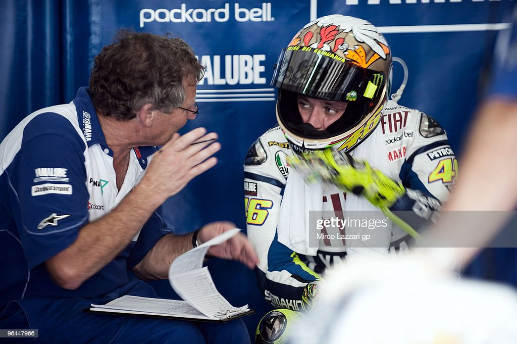 Valentino Rossi and Fiat Yamaha Team speaks with Jeremy Burgis of Australia (L) in box during the final day of the MotoGP test at Sepang International Circuit, near Kuala Lumpur, Malaysia on February 5, 2010.