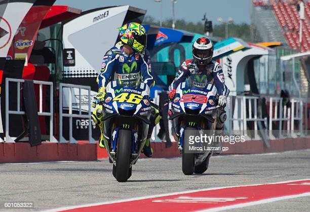 Valentino Rossi and Jorge Lorenzo of Movistar Yamaha MotoGP team are seen on the pit lane during MotoGP of San Marino Free Practice at Misano World...