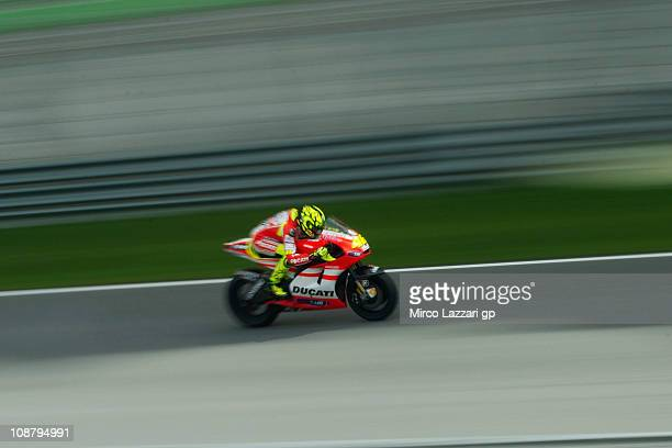 Valentino Rossi of Italy and and Ducati Marlboro Team heads down a straight during the third day of testing at Sepang Circuit on February 3 2011 in...