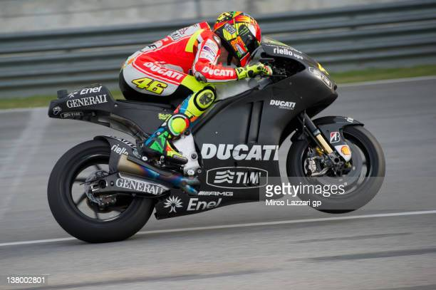 Valentino Rossi of Italy and and Ducati Marlboro Team lifts the front wheel during the first day of MotoGP testing at Sepang Circuit on January 31...