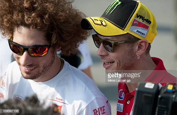 Valentino Rossi of Italy and and Ducati Marlboro Team speaks with Marco Simoncelli of Italy and San Carlo Honda Gresini before the second day of...