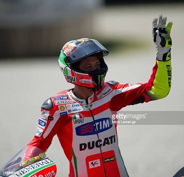 Valentino Rossi of Italy and Ducati Marlboro Team acknowledges fans at the end of the MotoGP race of the MotoGP of Italy at Mugello Circuit on July...