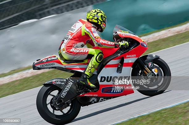 Valentino Rossi of Italy and Ducati Marlboro Team heads down a straight during the third day of testing at Sepang Circuit on February 24 2011 in...