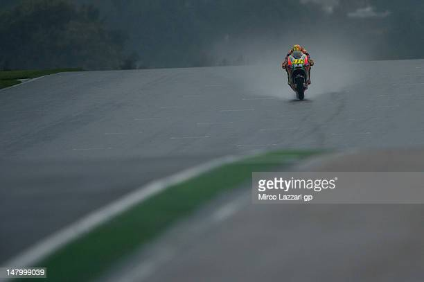 Valentino Rossi of Italy and Ducati Marlboro Team heads down a straight during the qualifying practice of the MotoGp of Germany at Sachsenring...