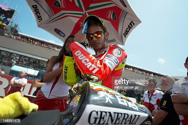 Valentino Rossi of Italy and Ducati Marlboro Team prepares before the start of the MotoGP race of the MotoGP of Italy at Mugello Circuit on July 15...