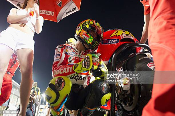Valentino Rossi of Italy and Ducati Marlboro Team prepares to start on the grid of the MotoGP race of MotoGP of Qatar at Losail Circuit on March 20...