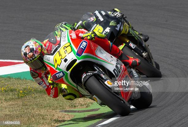 Valentino Rossi of Italy and Ducati Marlboro Team races during the MotoGP race of the MotoGP of Italy at Mugello Circuit on July 15 2012 in Scarperia...