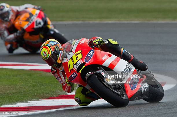 Valentino Rossi of Italy and Ducati Marlboro Team rounds the bend during the free practice of MotoGP of Great Britain at Silverstone Circuit on June...